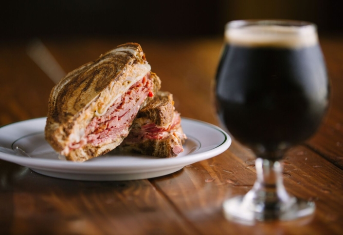 A Reuben sandwich is a great lunch companion for a craft beer stout by Public House Brewing.